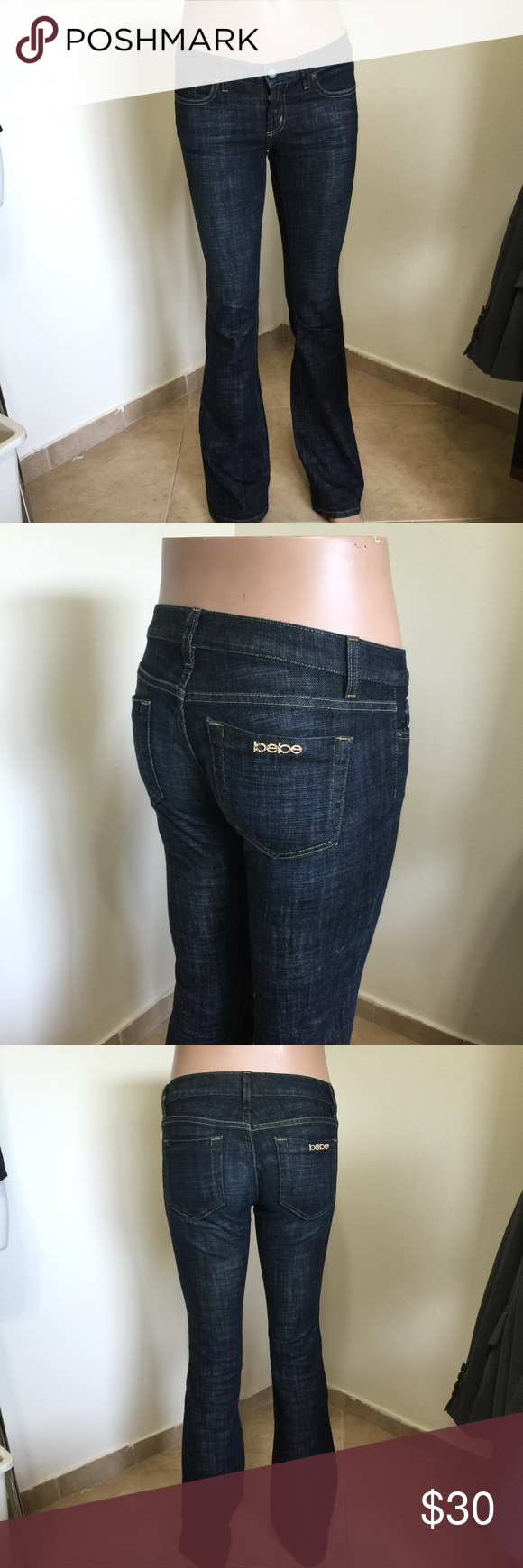 Bebe Bootcut Carmen Rivet Dark Wash Jeans w28 L34 Label-Bebe Jeans Style- Carmen Rivet Bootcut Jeans, dips in front, Gold/Rhinestone Logo on back pocket, (missing a few stones, not noticeable, l) flattering fit!  Size- W28 Shown on a size 4/6 mannequin Fits really nice.  Measurements-W-32 (Because low on hips) Hip-40 Length-34 Rise-7, Leg opening- 9 Color- Dark Wash  Fabric-98% Cotton, 2% Spandex Condition-Like new. worn and washed once Origin-USA These are the same size as the Rock and…