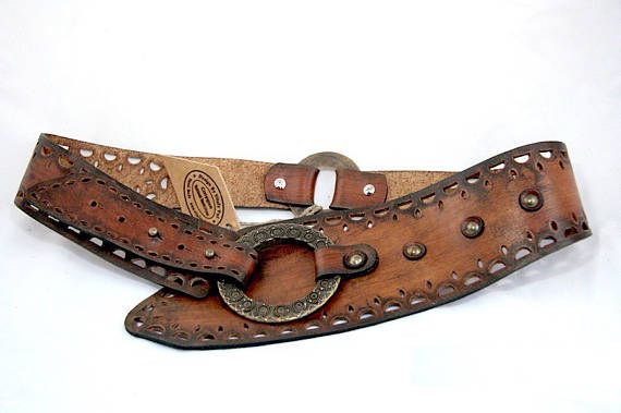 50722ffb7ee This wide leather belt could become a perfect accessory for any modern  western wear outfit