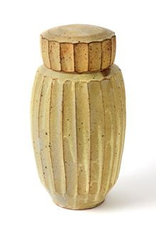 Warren MacKenzie (1924-);  Vase, ca. 1959;  Glazed stoneware: White glaze overlapping Tenmoku glaze with finger-combed surface designs;  9½ x 8½ inches;  Cockroft Memorial Fund, FCM 1959, 60.09.19; Want to see it in person? Find out where you can at http://www.mmaatreasures.org/pages/OurTreasuresHome/