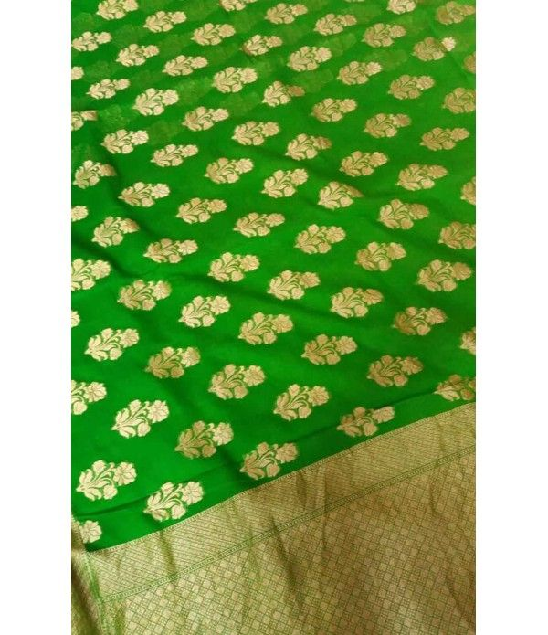 """Green Pure Handloom Khaddi Chiffon Saree --------------You can easily spot a Banarasi saree from the trademark flower and leaf motifs as well as the """"bootis"""" that are made on the fabric ----------------  luxurionworld.com"""