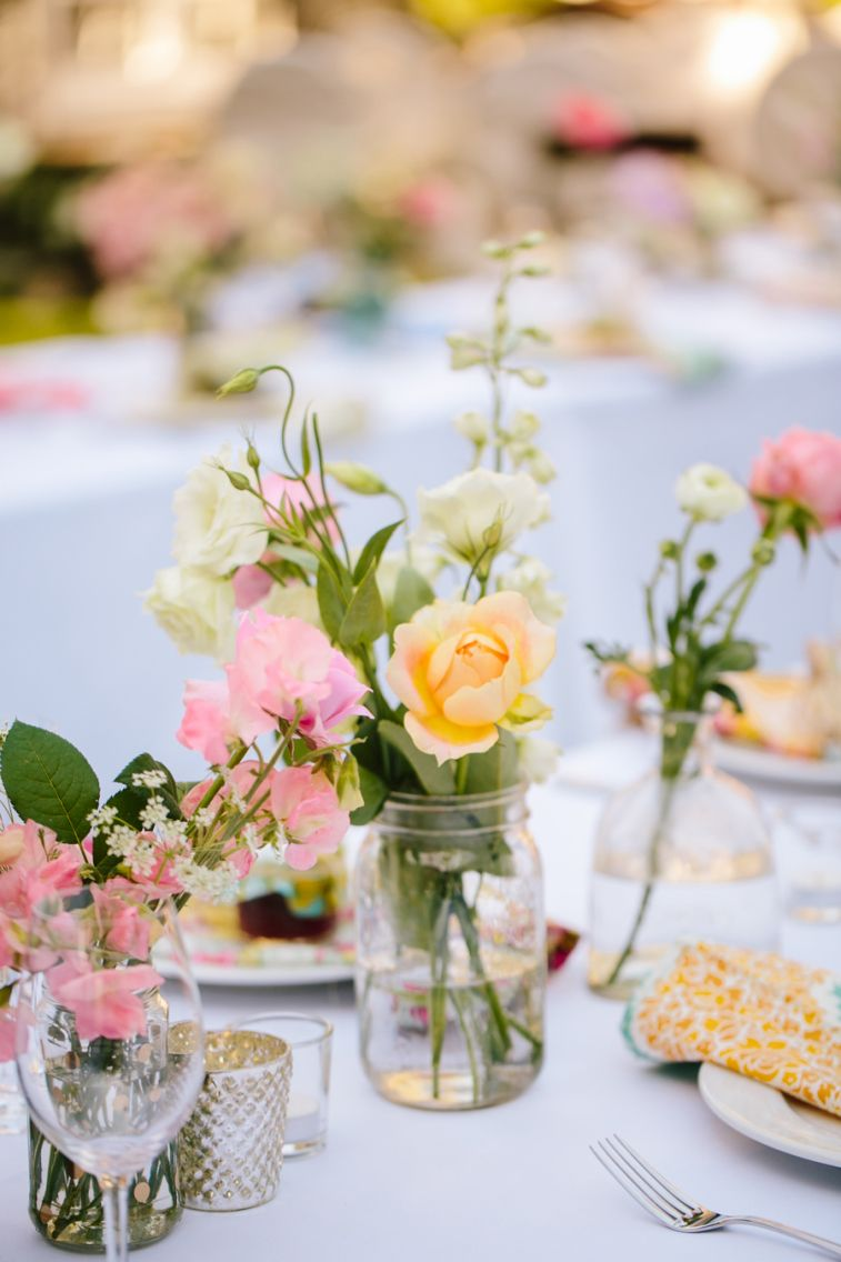 pastel flowers filled in old jar as wedding centerpiece #rusticcenterpiece #wedding #centerpiece