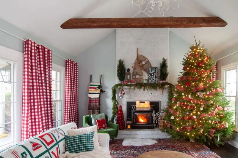 A rainbow Christmas tree, a handpainted ceramic Christmas village and lots more DIY touches in this colorful Christmas home decorating tour! #colorfulhomedecor #rainbowchristmastree #DIYchristmasdecoratingideas #christmashometour #spectrumtree #christmashomedecor