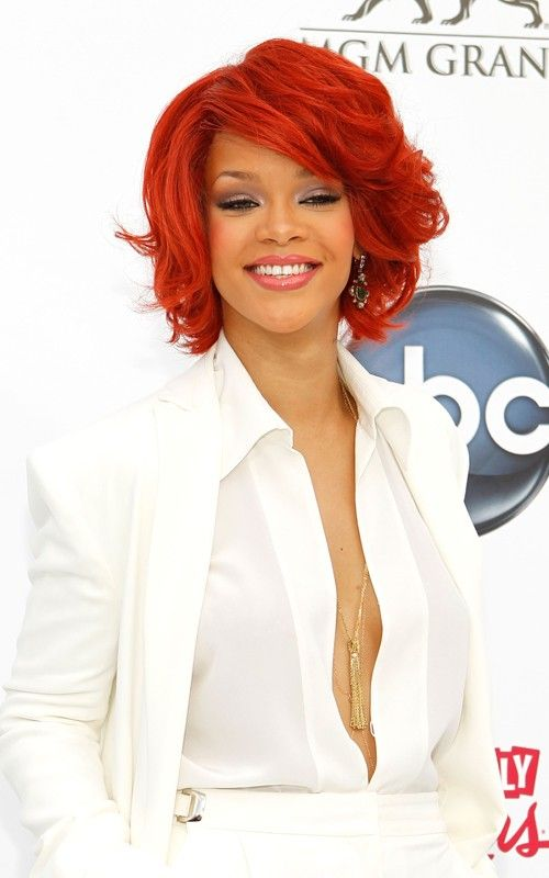 Rihanna at the billboard 2011 awards...stunning contrast between her flaming hair and the white suit.