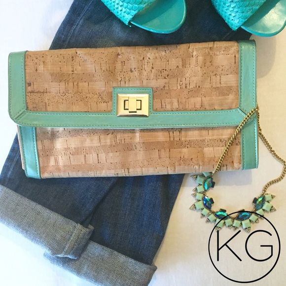 """Aldo Cork & Teal Clutch In great pre-owned condition! •Cork material with teal edging and silver clasp •Two interior compartments and two inner zipper pockets •11.5"""" wide, 6.5"""" tall, expands to approx. 1.5"""" deep no trades nor lowball offers Thank you for shopping in my closet! ALDO Bags Clutches & Wristlets"""