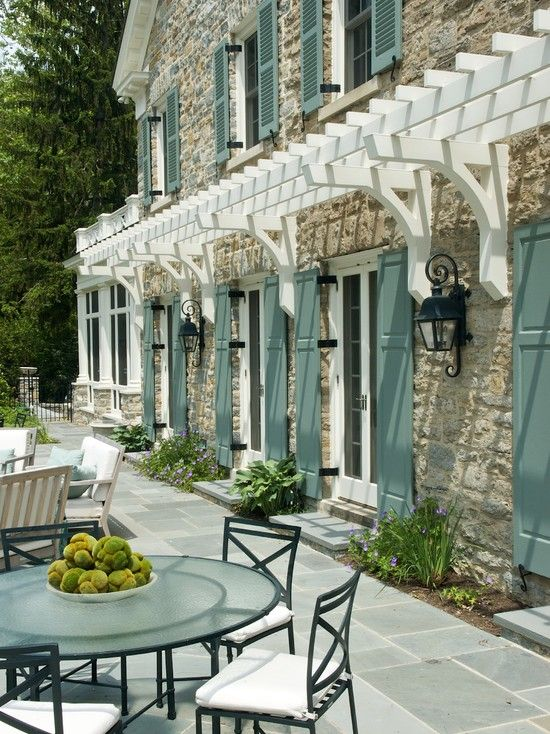 Traditional Exterior Design- love this combination of the stone, shutters and white trim.