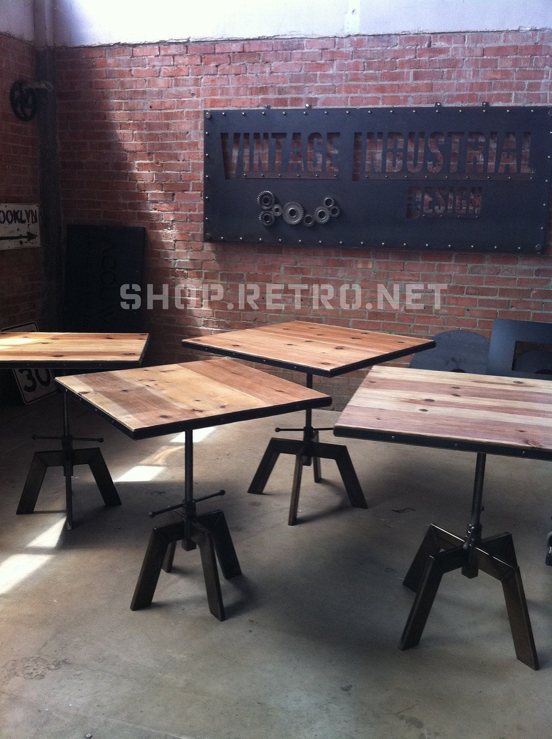adjustable height is a great idea. vintage industrial cafe table