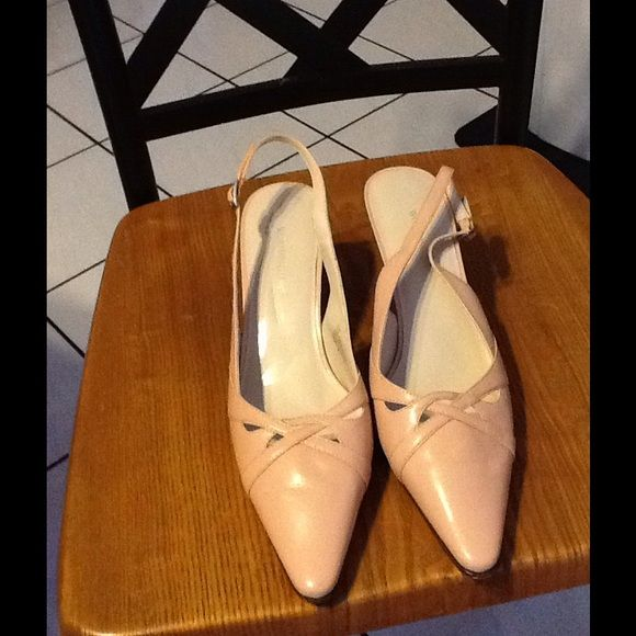 Pink Sling Back Dress Shoe These shoes are pink sling back leather shoe. They can be worn with pants or a dress/skirt. They have been worn twice and are in good condition. These are a very light pink. Worthington Shoes Heels