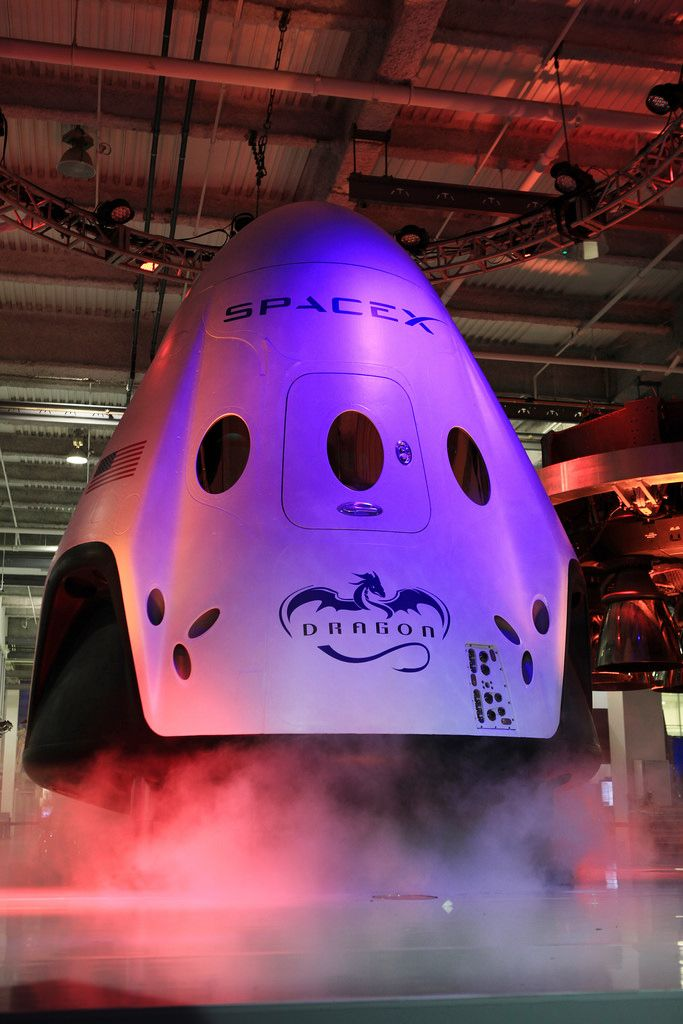 HAWTHORNE, Calif. - The Dragon V2 stands on a stage inside SpaceX headquarters in Hawthorne, Calif., during its unveiling. The spacecraft is designed to carry people into Earth's orbit and was developed in partnership with NASA's Commercial Crew Program under the Commercial Crew Integrated Capability agreement. SpaceX is one of NASA's commercial partners working to develop a new generation of U.S. spacecraft and rockets capable of transporting humans to and from Earth's orbit from American…