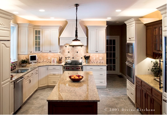 Traditional white kitchen design with contrasting brown island