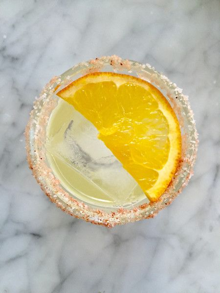 Mezcal is the incredible smoky cousin of tequila. Rimmingthe rocks glass with Chipotle Chili Salt picks up on that smoky flavor beautifully, and some orange ju