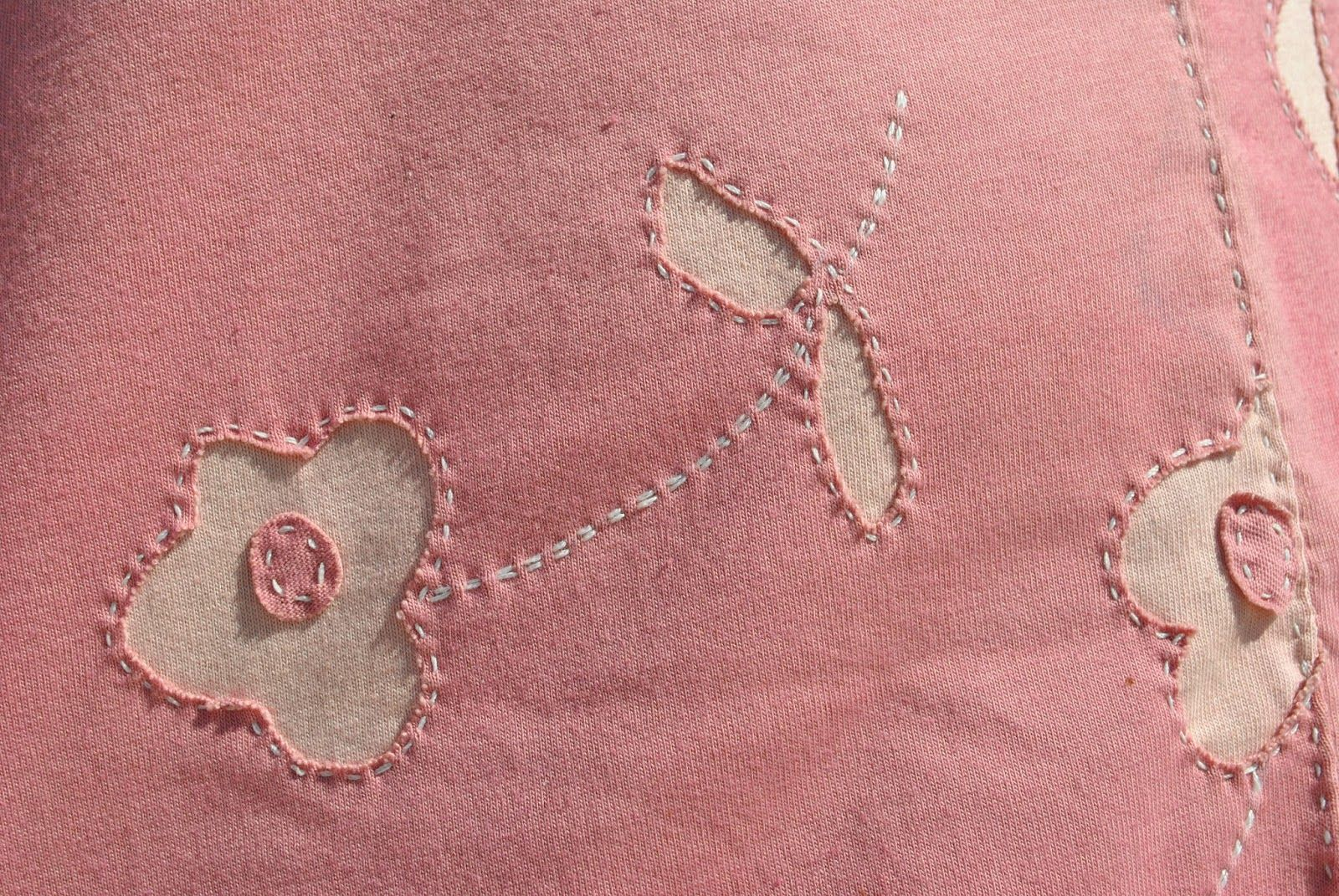 Alabama chanin; reverse appliqué with showy stitches. applique