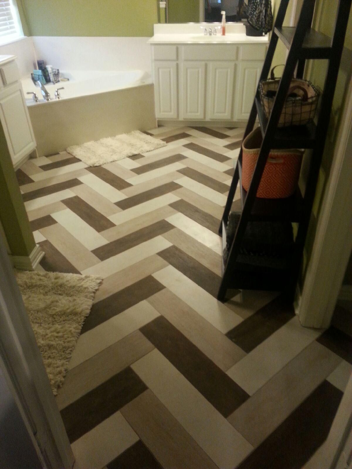 Wood look multi color tile layed on a herringbone pattern wood look multi color tile layed on a herringbone pattern dailygadgetfo Gallery