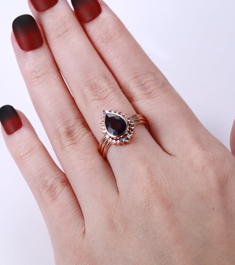 Rose gold engagement ring set with a pear shaped Amethyst