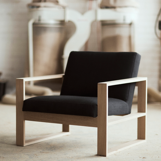 The Box Chair is part of Simple furniture - The Box Chair, which features a solid timber frame and 6 options of upholstery, is a favourite at the Mr and Mrs White headquarters  With clean lines and detailed upholstery  once you sit in this chair you won't want to get out  Dimensions  800w x 750d x 730h Timber Options American Oak Ash Walnut Maple Upholstery Options Fabric  Concrete, Chalk, Stucco, Butterbean, Dijon, Gravel, Coal, Shadow, Tundra, Chrome Leather  Black, Tan, White Speciality  Blush Shearling All furniture is handmade in Sydney Australia  Please allow 68 weeks for production  Please note the quoted price does not include delivery  We will invoice you separately with the price for freight depending on the item ordered and your location within Australia  Free local pickup option available at checkout  Learn more about our timbers and finishes  Read more