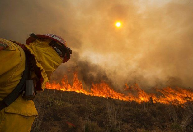 A firefighter keeps watch as a wildfire burns along a hillside in Point Mugu, Calif., Friday, May 3, 2013. Read article