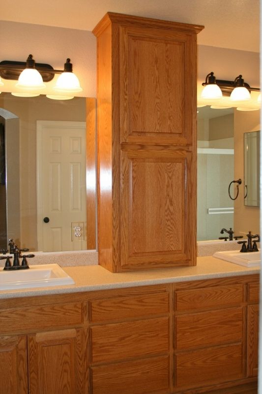 Adding A Cabinet On Top Of A Long Counter Between Sinks In The Bathroom Is A G Bathroom Counter Storage Bathroom Countertop Storage Bathroom Countertop Cabinet