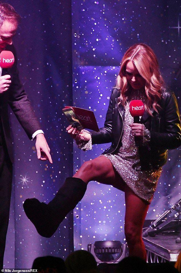 Amanda Holden looks glam despite foot brace at Christmas