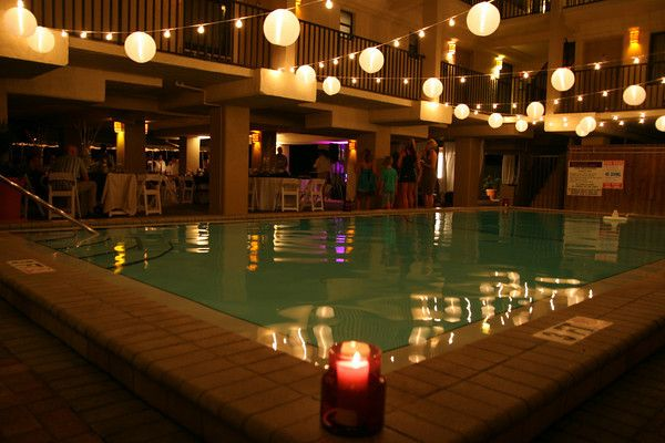 Canopy Of Lights With Lanterns Over A Pool For A Wedding On