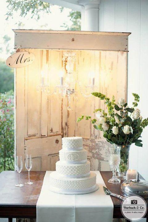 Bridal Cake Display with wooden doors and chandelier   Bella Spree ...