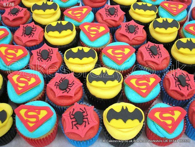 Superheroes Cupcakes Themed In Bright Coloured Cases Decorated With A Blob Of Brightly