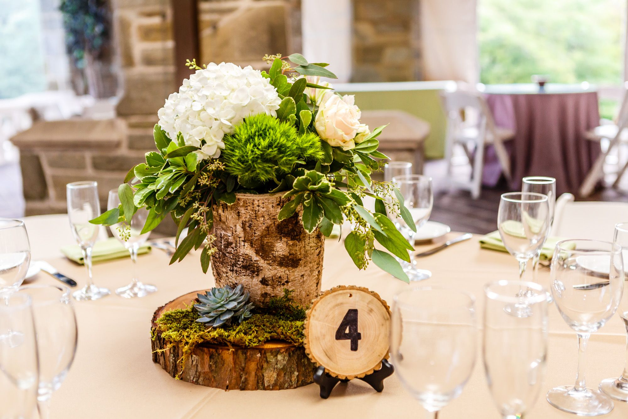 Birch Wood Centerpieces With Hydrangeas And Greenery And Wood Slab Table Numbers Wood Centerpieces Wood Slab Centerpiece Wedding Wood Centerpieces Wedding