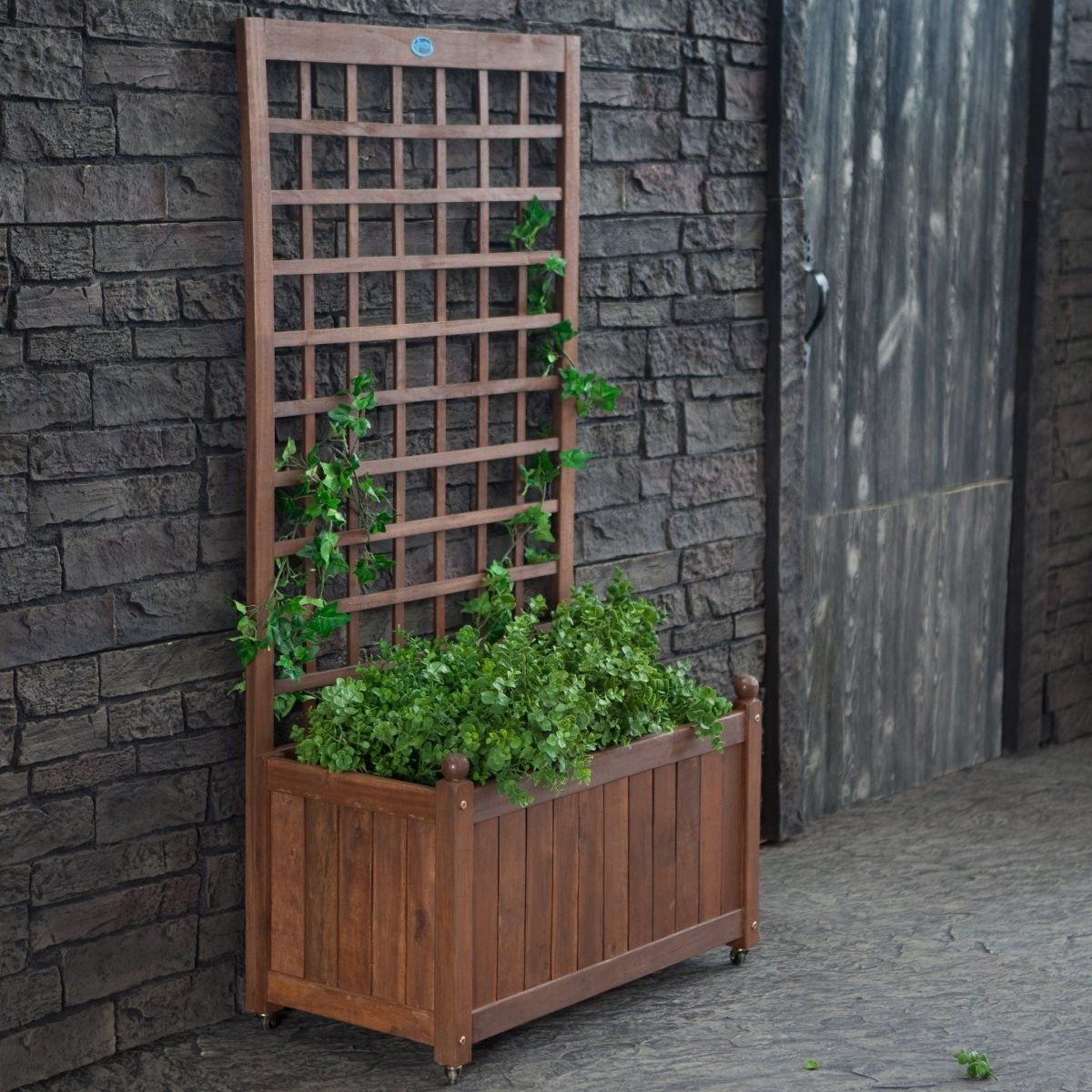 wood planter box on wheels with grid style trellis planters