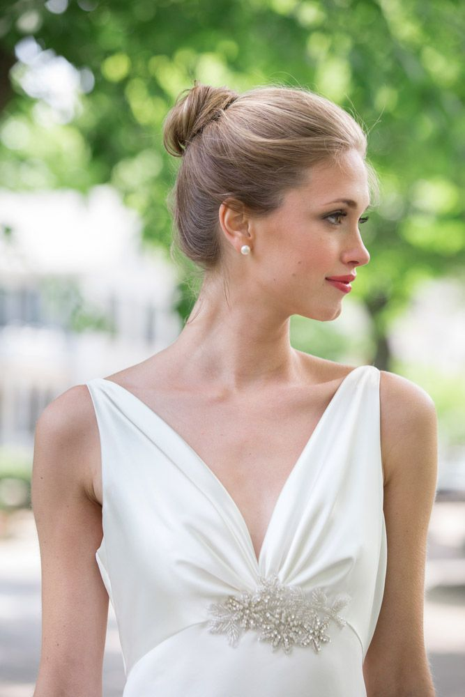 A simple gown befits a graceful bride, as seen in: Demure and Dapper on Nantucket | Southern New England Weddings Photo by: Katie Kaizer Photography
