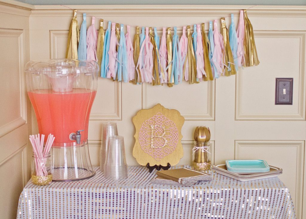Drink stations - love this gold sequin tablecloth and tassel garland!
