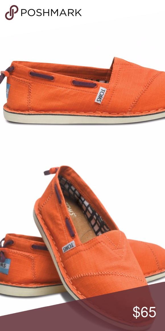 7806d7e430f Never ever worn. Inspired by life at sea  the simplicity of heading out and  dropping anchor anywhere. The world s a boardwalk in Orange Biminis. TOMS  ...