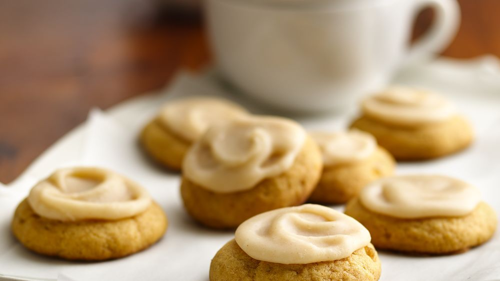 Add a gingery twist to these homemade pumpkin cookies that are topped with butter frosting - perfect for dessert.