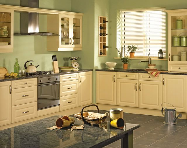 Psychologically The Happiest Color In The Spectrum Is Yellow Which Makes Yellow Kitchen Appliances And Yellow Kitchen Cabinets Kitchen Design Yellow Kitchen
