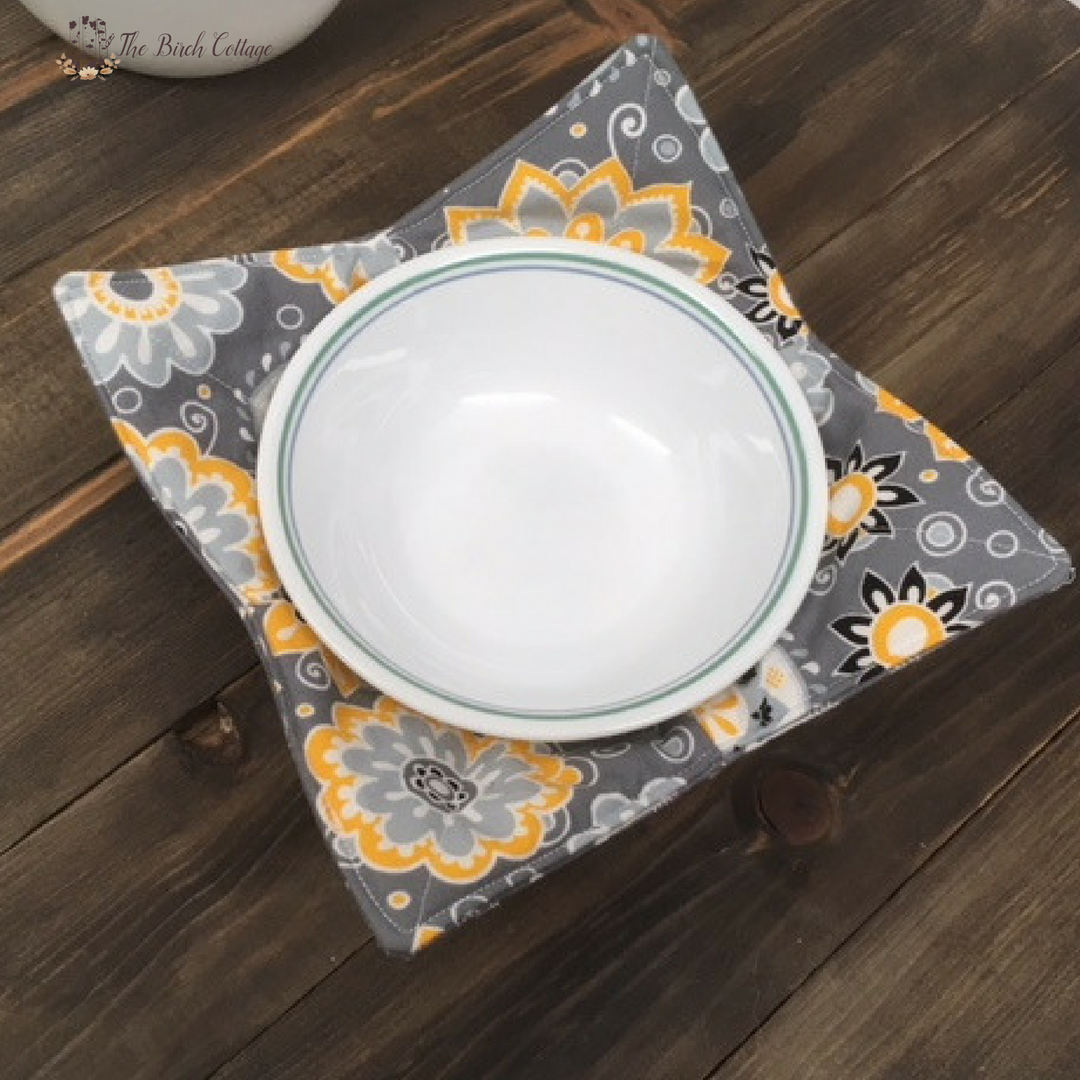 Learn to sew a microwave safe bowl cozy using cotton fabric, batting and thread. These microwave safe bowl cozies will protect your hands from heat & cold!
