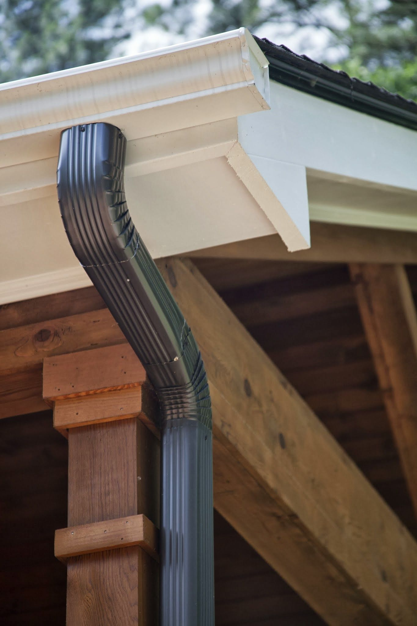 Athens ga project white gutters with bronze downspouts for Does a house need gutters