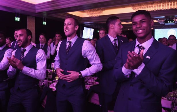 Andros Townsend, Harry Kane, Chris Smalling and Marcus Rashford cheer on Wayne Rooney and Gary Neville on stage