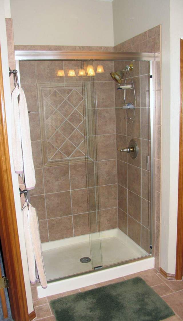 Prefab shower stall lowes bathrooms pinterest prefab small showers and basements Tile shower stalls
