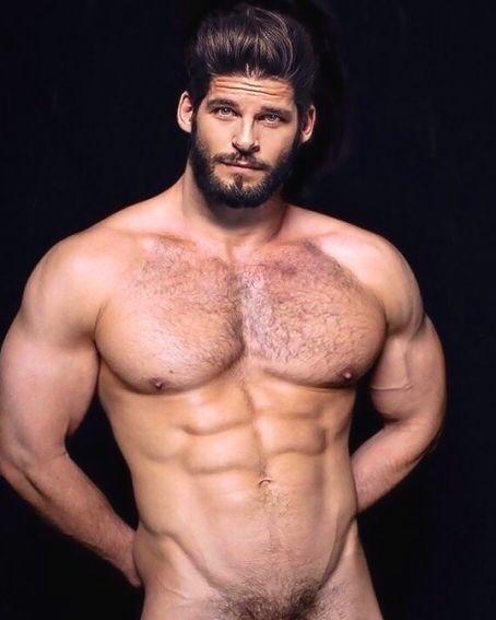 muscled hunk sprays bear