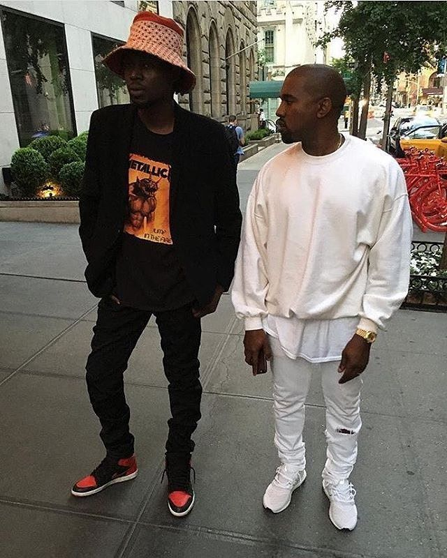 Kanye West Is Wearing White Gildan Sweater Rolex Day Date And White Jeans By Acne Paired With Adidas U Kanye West Outfits Best Running Gear Ultra Boost Outfit