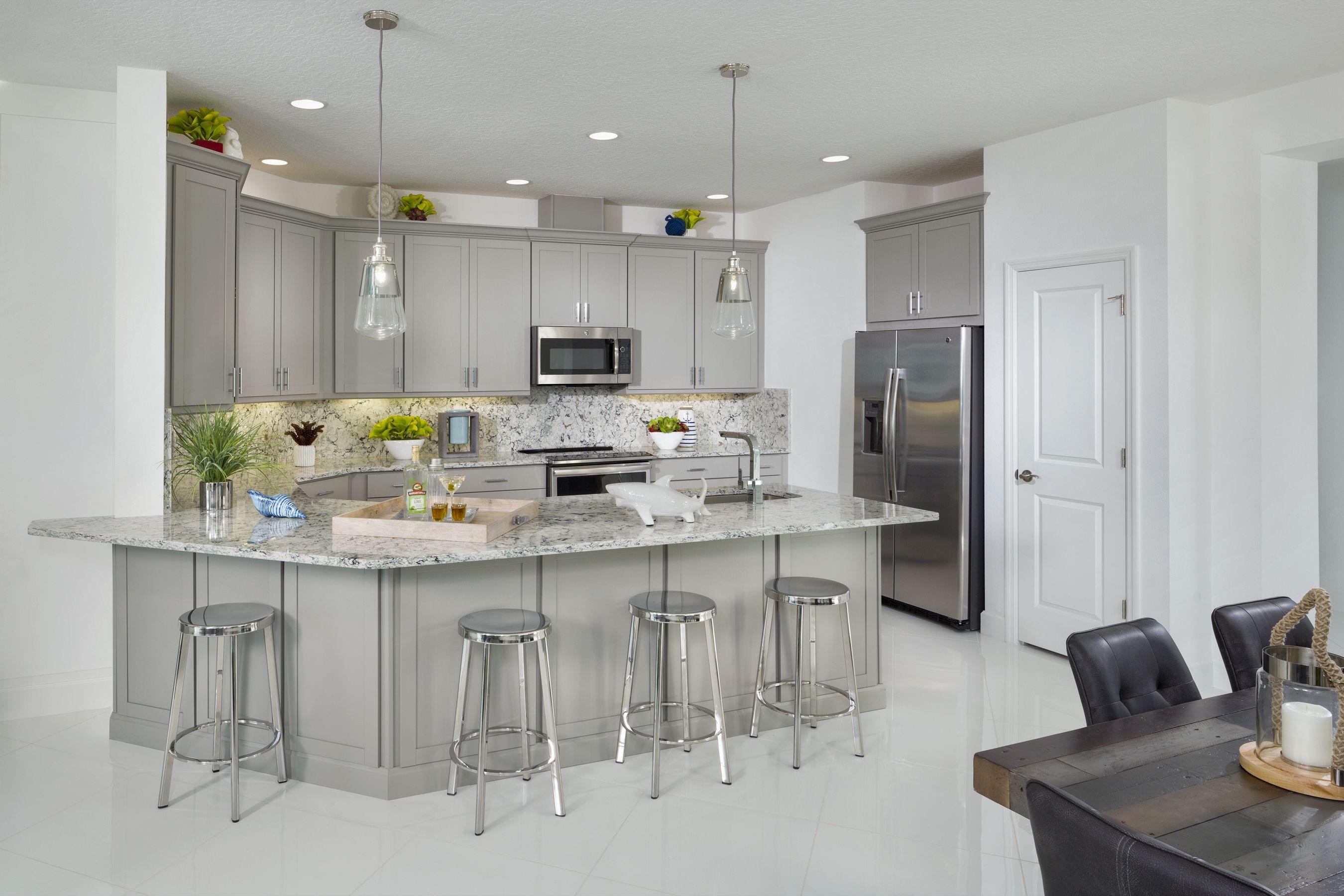 Barbuda Model At Latitude Margaritaville Daytona Beach Minto Communities New Homes Breakfast Bar Kitchen Kitchen Diner
