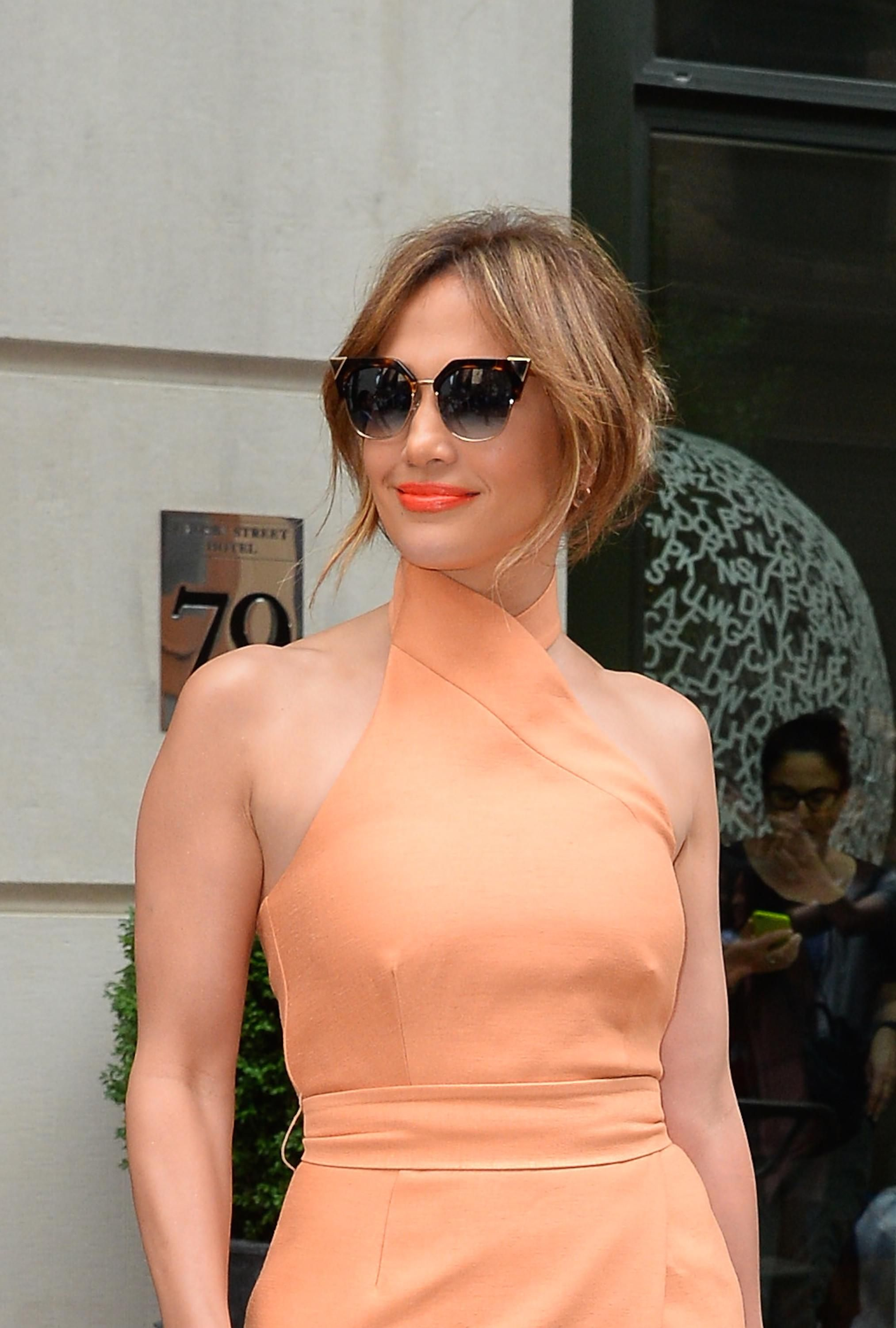 41ba7cad57 Jennifer Lopez is peachy-keen in her Fendi Iridia sunglasses. Find your  summer shades on Fendi.com!