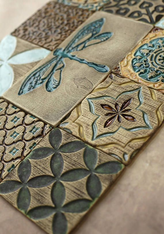 Photo of These tiles were hand painted in a multicolored glaze on a rustic background – Background