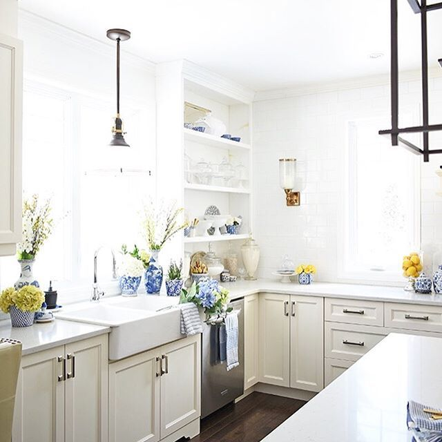 spring inspo styling in kitchen with blue and white pottery and fresh blooms so pretty on kitchen interior yellow and white id=92238