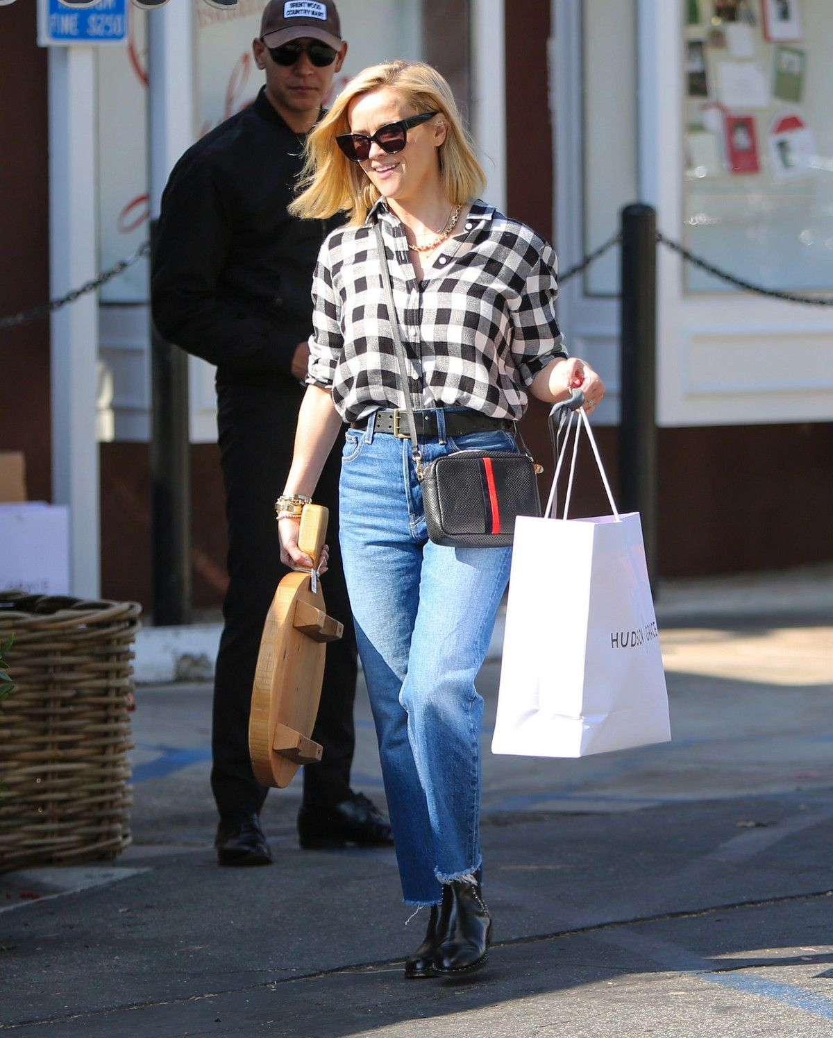 Early Christmas Shopping 2020 Reese Witherspoon in checked shirt with denim early Christmas