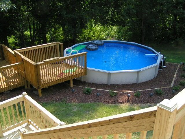 Pictures of 18 above ground pools with decks for Above ground pool decks houston tx