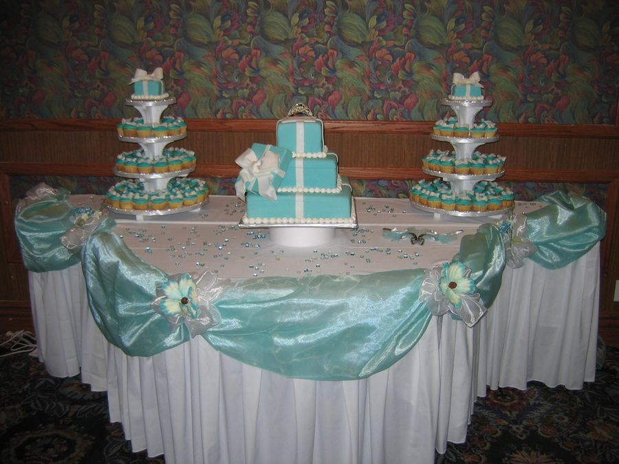 This cake was hard but very fun to do, all cakes are iced in whipped icing then covered in rolled fondant.