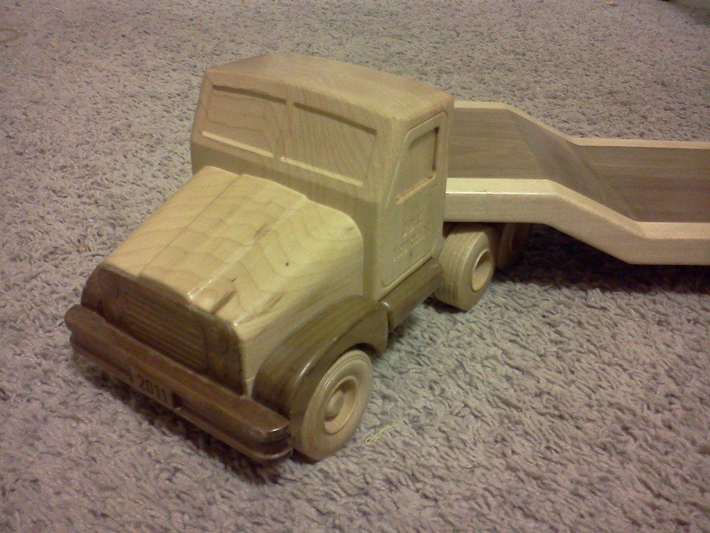 "Toy truck and trailer made from solid maple and walnut hardwoods. The trailer has a hitch and detaches from the truck. This was a Christmas present for my son. The year it was made is engraved in the ""license plate"" and his name is on the door. This was a lot of fun to make and he loves it."