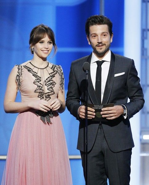 Presenters Felicity Jones and Diego Luna are seen onstage during the 74th Annual Golden Globe Awards.