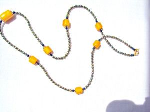 SALE     Illusion Necklace of Olive Green Pearls Chain and Yellow Amber Focal ... one of a kind. Was 75.00 now, $67.50 SHIPPING IS FREE