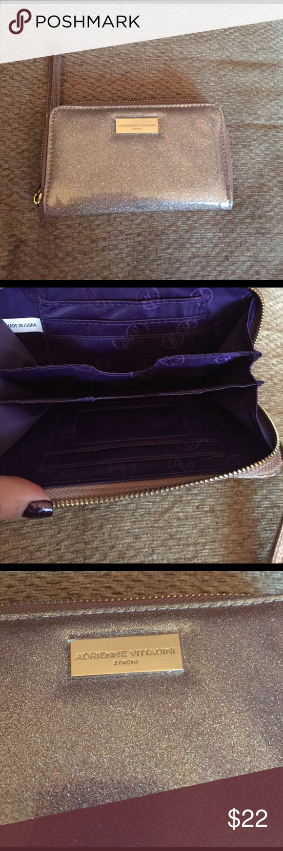 Patent leather glitter wristlet- NWOT Brand new never used. Still has plastic over the name brand plate. Adrienne Vittadini. Purple interior with lots of pockets, i.d. Window and a place for cell phone. Wristlet arm band. Champagne colored glitter patent leather. Perfect condition Adrienne Vittadini Bags Clutches & Wristlets