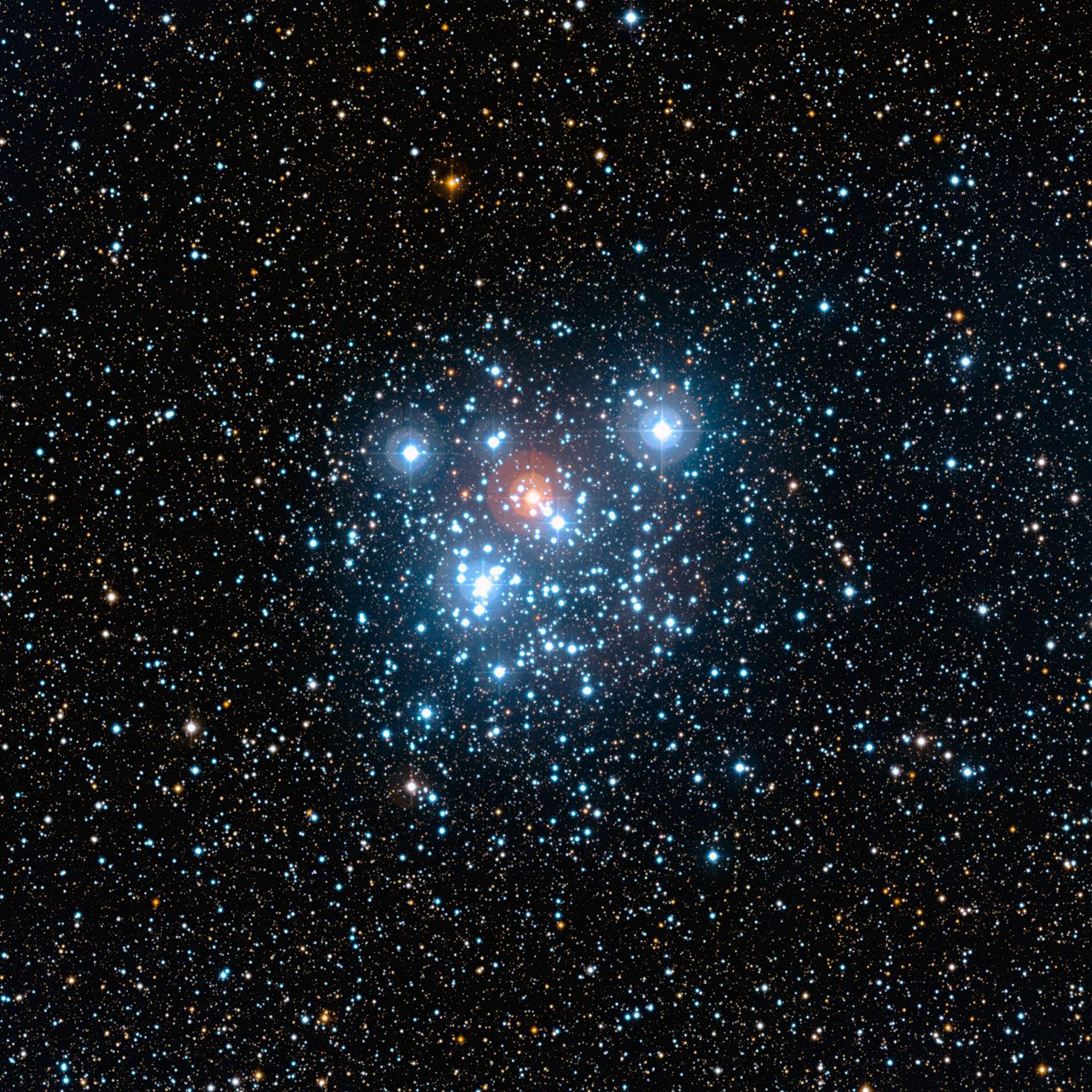 Wide Field Image of the Jewel Box. This image of the well-known NGC 4755 cluster or Jewel Box was taken with the Wide Field Imager (WFI) on the MPG/ESO 2.2-metre telescope at ESO's La Silla Observatory. It highlights the cluster and its rich surroundings in all their multicoloured glory. The field of view is 20 arcminutes across. The picture is based on images obtained through B, V and I filters.