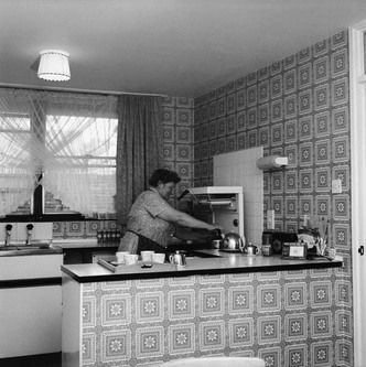 1974 - A women in the kitchen of a flat, Marquess Estate